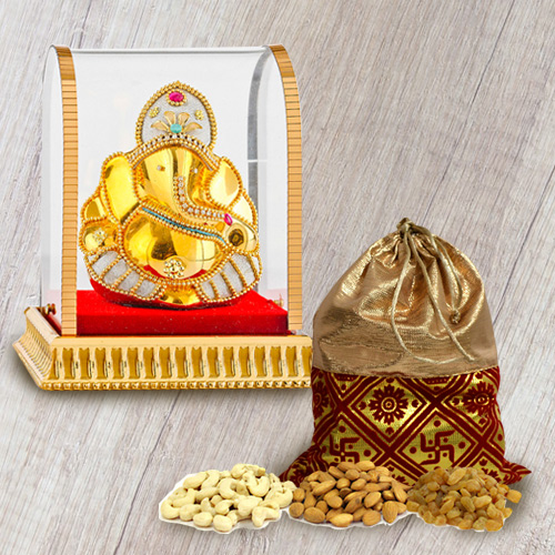 Remarkable Vighnesh Ganesha Idol with Mixed Dry Fruits Potli