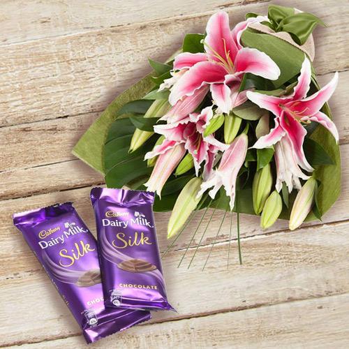 Wonderfully Arranged Pink Lilies Bunch with Dairy Milk Silk