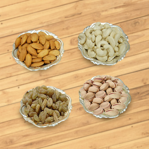 Delectable mixed Dry Fruits with Silver plated bowls