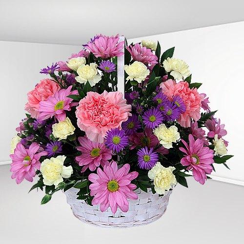Seasonal Arrangement of Carnation Flowers in a Basket