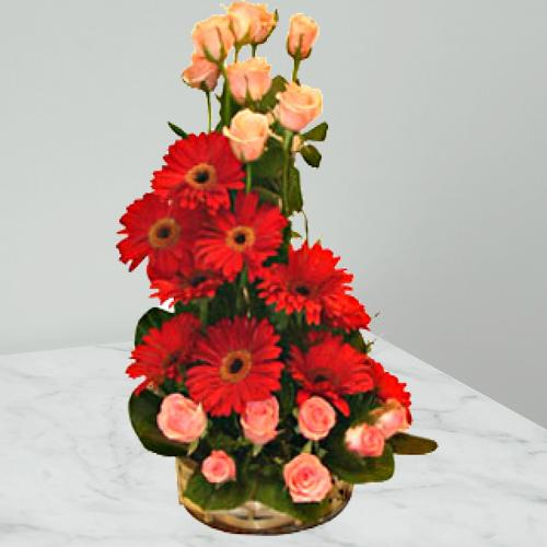 Jingling Endearment Roses and Gerberas Special Arrangement