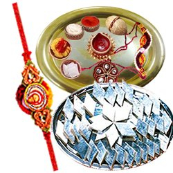 Amazing Rakhi Special Gift of Golden Plated Thali  and Kaju Katli from Haldiram and with free Rakhi, Roli Tilak and Chawal for your Dear Brother