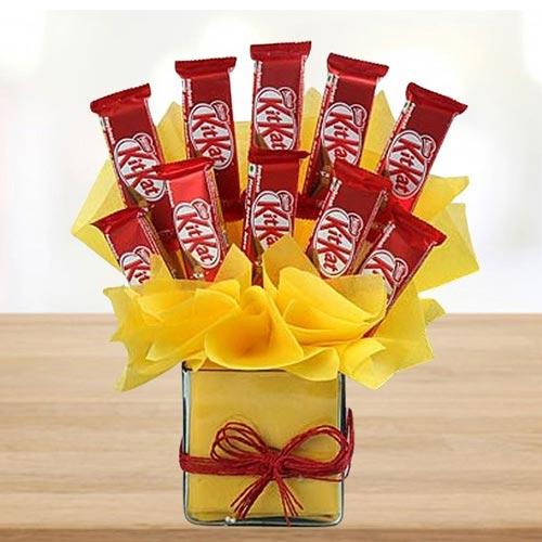 Marvelous Arrangement of Kitkat Chocolates in Glass Vase