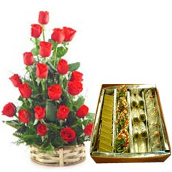 1/2 Kg. Assorted Sweets with 18 Red Roses Basket