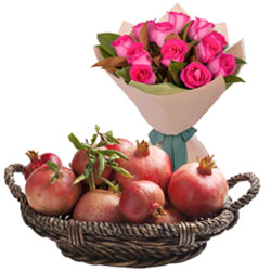 Exotic Pink Roses Bouquet with Pomegranates in Basket
