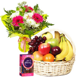 Classic Gift Hamper of Cadbury Celebration Pack with Mixed Flowers Bouquet and Mixed Fruits Basket