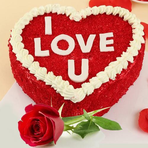 Arresting Combo of Heart Shape Red Velvet Cake with Single Red Rose