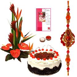 Mesmerizing Combo Gift Pack of Seasonal Flowers Bouquet, Bakery Fresh Cake and Card with free Rakhi, Roli Tilak and Chawal
