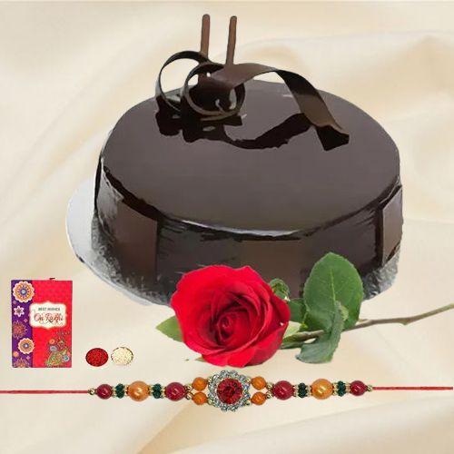 Splendid Combo Gift of Yummy Chocolaty Cake and a Single Rose with Free Rakhi Roli Tilak and Chawal
