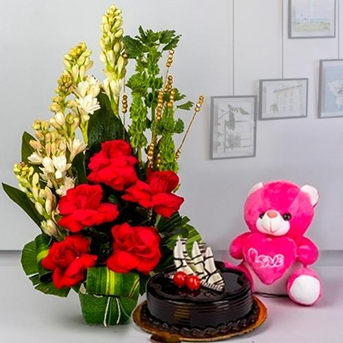Luxurious Combo of Fresh Flowers with Small Teddy, Chocolate Cake n Cadbury Celebration Pack