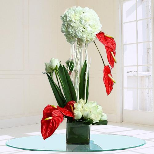 Remarkable Assorted Flowers Arrangement in Glass Vase
