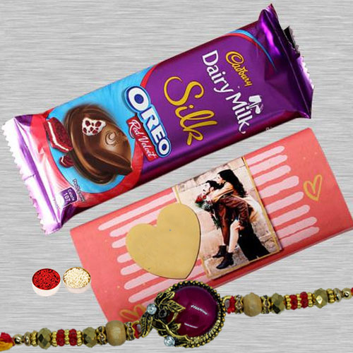 Graceful Big Red Stone Rakhi N Dairy Milk Silk, Roli Chawal N Card