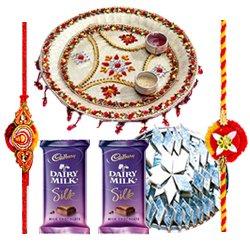 Wonderful Pooja Thali, Yummy Kaju Katli, Gift Voucher from Pantaloons with 2 free Rakhi, Roli Tilak and Chawal