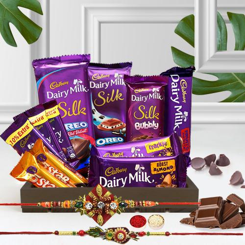 Splendid Twin Rakhi with Cadbury Chocolate Treat Hamper