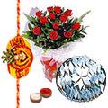 Delicious Kaju Katli and Roses Gift Set with Free Rakhi, Roli Tilak and Chawal for the Occasion of Raksha Bandhan<br>
